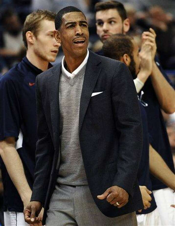 Connecticut head coach Kevin Ollie reacts during the second half of an NCAA college basketball game against Rutgers in Hartford, Conn., Sunday, Jan. 27, 2013. Connecticut won 66-54.(AP Photo/Jessica Hill) Photo: AP / FR125654 AP
