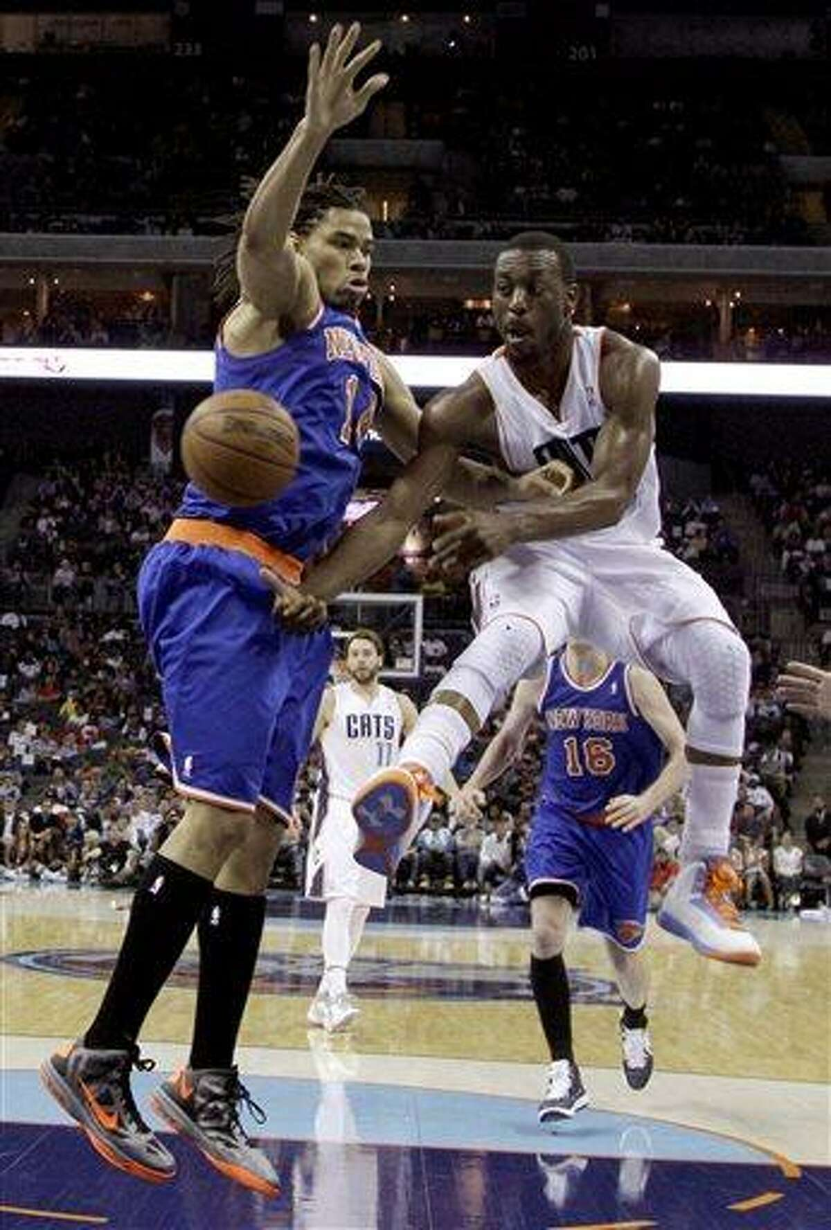 Charlotte Bobcats' Kemba Walker, right, passes the ball around New York Knicks' Chris Copeland, left, during the second half of an NBA basketball game in Charlotte, N.C., Monday, April 15, 2013. The Bobcats 106-95. (AP Photo/Chuck Burton)