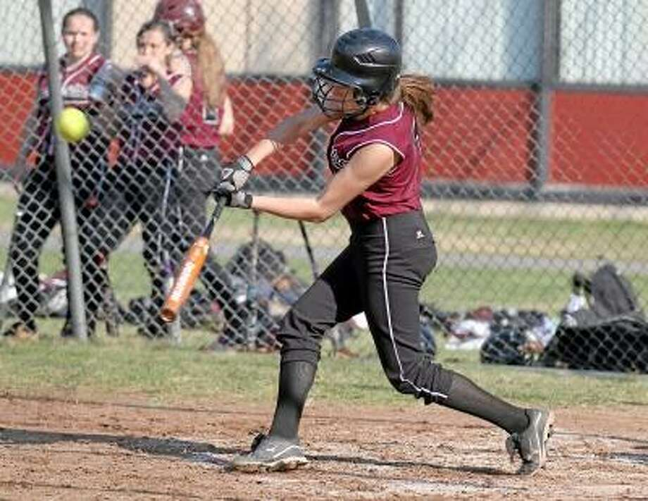 Marianne Killackey/Special to the Register Citizen  Torrington's Brittany Young smashes a triple for two RBI's in her team's win over Wilby in the first game of a double header Monday afternoon. / 2013