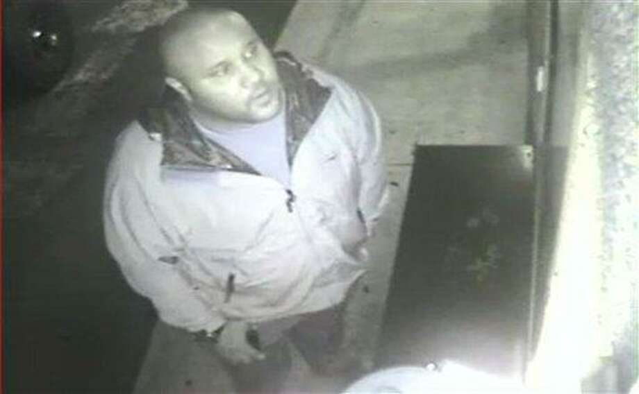 ADDS DATE VIDEO WAS TAKEN - This image provided by the Irvine Police Department shows Christopher Dorner from Jan. 28, 2013 surveillance video at an Orange County, Calif., hotel. More than 100 officers, including SWAT teams, were driven in glass-enclosed snow machines and armored personnel carriers in Big Bear Lake to hunt for this former Los Angeles police officer suspected of going on a deadly rampage to get back at those he blamed for ending his police career. (AP Photo/Irvine Police Department) Photo: AP / Irvine Police