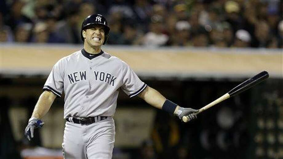 New York Yankees' Mark Teixeira reacts after taking a strike from Oakland Athletics' Jerry Blevins in the eighth inning of a baseball game Tuesday, June 11, 2013, in Oakland, Calif. (AP Photo/Ben Margot) Photo: AP / AP
