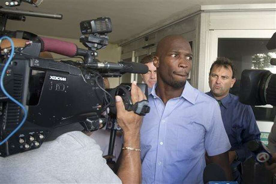 Chad Johnson leaves the Broward County Jail in Fort Lauderdale, Fla., Monday, June 17, 2013. A contrite Johnson apologized Monday for disrespecting a judge when the former NFL star slapped his attorney on the backside in court last week and was released from jail after only a week instead of 30 days. Broward County Circuit Judge Kathleen McHugh accepted Johnson's apology and cut back his jail term for a probation violation to the seven days he had already served since the rear-swatting. (AP Photo/J Pat Carter) Photo: AP / AP