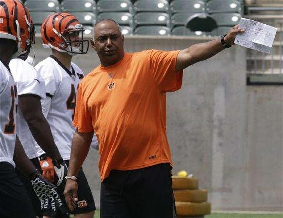 Cincinnati Bengals head coach Marvin Lewis directs practice during the NFL football team's mandatory mini-camp, Thursday, June 13, 2013, in Cincinnati. (AP Photo/Al Behrman)