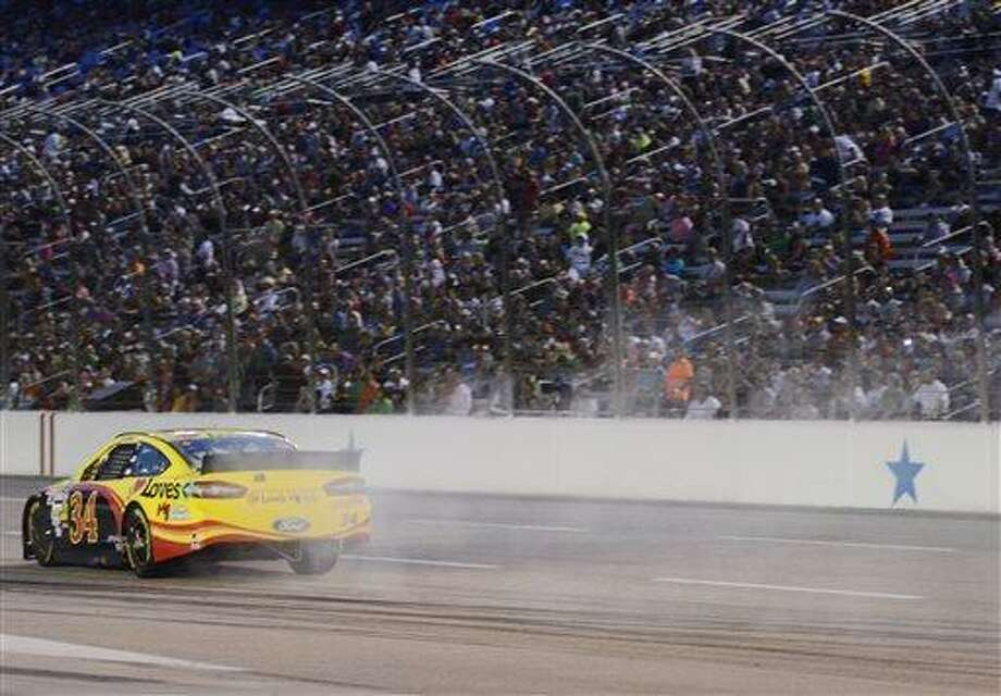 Sprint Cup Series driver David Ragan (34) heads in to pit row with smoke coming out of his car during the NASCAR Sprint Cup series NRA 500 auto race at Texas Motor Speedway, Saturday, April 13, 2013, in Fort Worth, Texas. (AP Photo/Larry Papke) Photo: AP / FR58581 AP