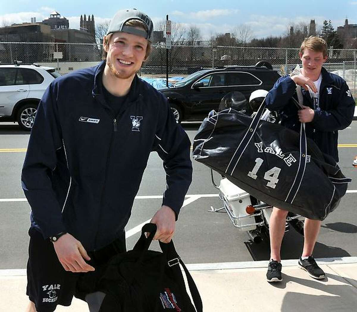 The NCAA men's national hockey champions, Yale University, including outstanding goaltender Jeff Malcolm, left, and Ryan Obuchowski, returns home from the Frozen Four in Pittsburgh, where they beat crosstown rivals Quinnipiac Univeristy, 4-0. Mara Lavitt/New Haven Register mlavitt@newhavenregister.com4/14/13