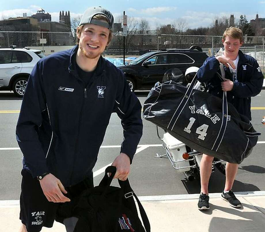 """The NCAA men's national hockey champions, Yale University, including outstanding goaltender Jeff Malcolm, left, and Ryan Obuchowski, returns home from the Frozen Four in Pittsburgh, where they beat crosstown rivals Quinnipiac Univeristy, 4-0. Mara Lavitt/New Haven Register <a href=""""mailto:mlavitt@newhavenregister.com"""">mlavitt@newhavenregister.com</a>4/14/13"""