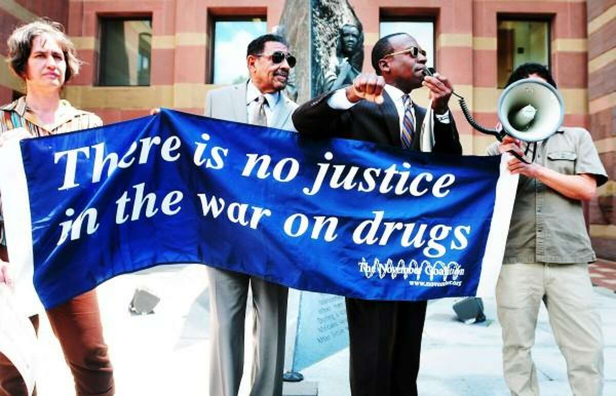 Arnold Gold/New Haven Register Community activist Kevin Muhammad (second from right) speaks at a protest about the War on Drugs in front of CIty Hall in New Haven on 6/17/2013. Left to right are Tisa Wenger, Jimmie Griffin, Muhammad and John Lugo.
