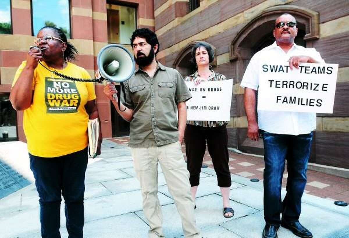 Arnold Gold/New Haven Register Barbara Fair (left) speaks at a protest about the War on Drugs in front of CIty Hall in New Haven on 6/17/2013. Left to right are Fair, John Lugo, Tisa Wenger and Robert Lee.