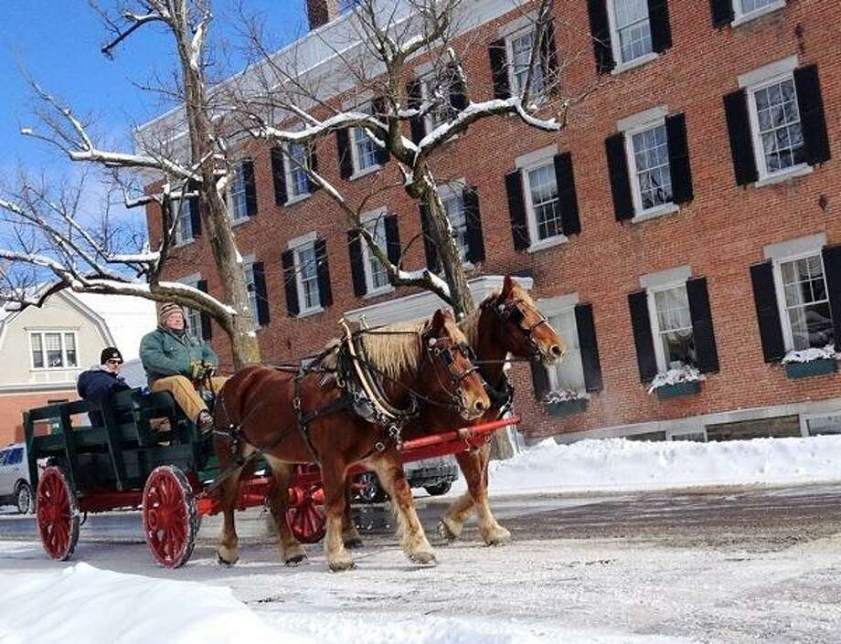 Photo by JOHN HAEGER @oneidaphoto on Twitter/Oneida Daily Dispatch A horse and wagon team makes its way along the street as part of  the annual winter festival in Cazenovia on Saturday, Feb. 9, 2013.