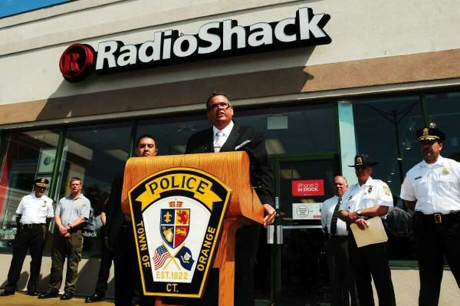 Mara Lavitt/New Haven Register  June 17, 2013 Police from eight Connecticut municipalities along with two Federal agencies cracked a string of robberies at area Radio Shack stores. New Haven Det. Sgt. Robert Lawlor, Jr. addressed the media in front of the Orange store.