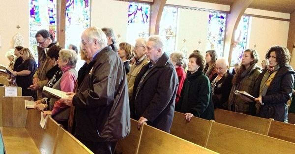 JOHN HAEGER @oneidaphoto on Twitter/Oneida Daily Dispatch People fill the church during the memorial Mass for Carmen Basilio at St. Agatha's in Canastota on Saturday, Feb. 9, 2013.
