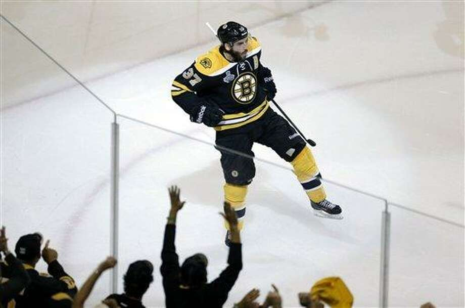 Boston Bruins center Patrice Bergeron celebrates his goal against the Chicago Blackhawks during the second period in Game 3 of the NHL hockey Stanley Cup Finals in Boston, Monday, June 17, 2013. (AP Photo/Charles Krupa) Photo: AP / AP