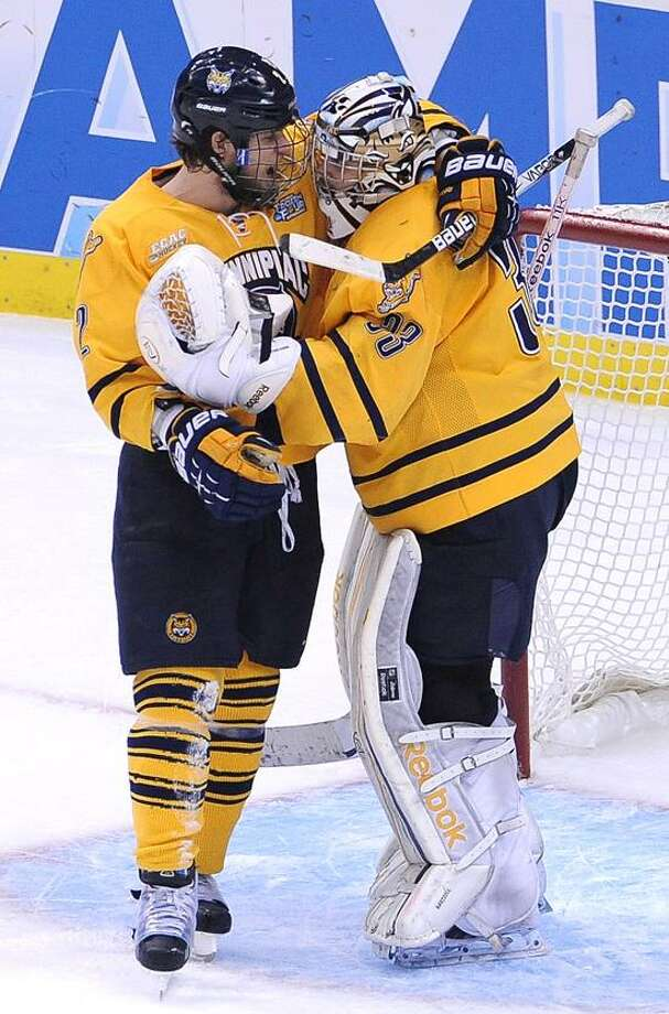 "Pittsburg, PA--  Quinnipiac's Mike Dalhuisen hugs goalie Eric Hartzell after they beat St. Cloud 4-1 to advance to the National Championship game against Yale.  Photo-Peter Casolino/Register <a href=""mailto:pcasolino@newhavenregister.com"">pcasolino@newhavenregister.com</a>"