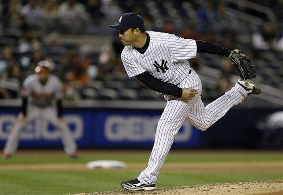 New York Yankees Hiroki Kuroda pitches in the fifth inning of a baseball game against the Baltimore Orioles at Yankee Stadium in New York , Sunday, April 14, 2013.  (AP Photo/Kathy Willens) Photo: AP / AP
