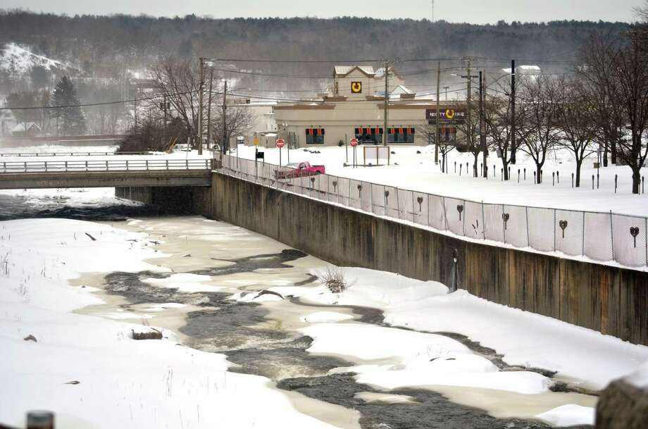 Snow and ice cover much of the Naugatuck River where it runs through the city of Torringon.John Berry/Register Citizen.