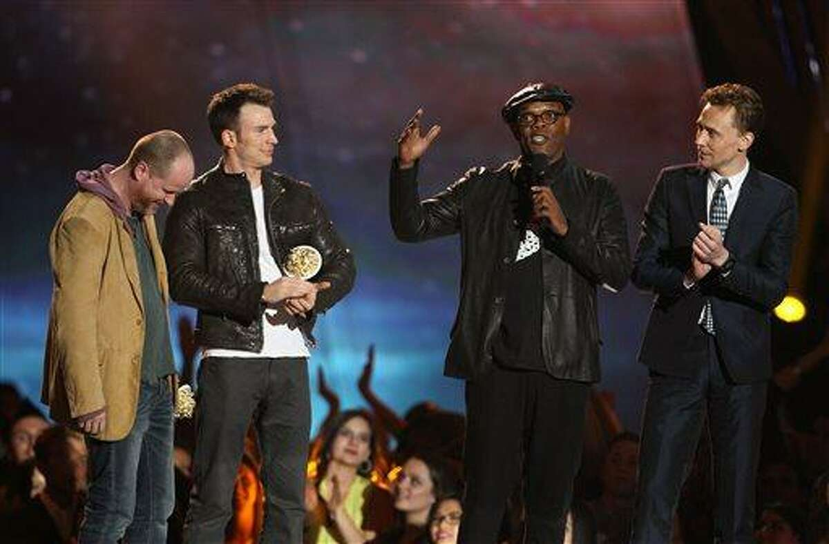 Joss Whedon, Chris Evans, Samuel L. Jackson and Tom Hiddleston, from left, accept the award for best fight for