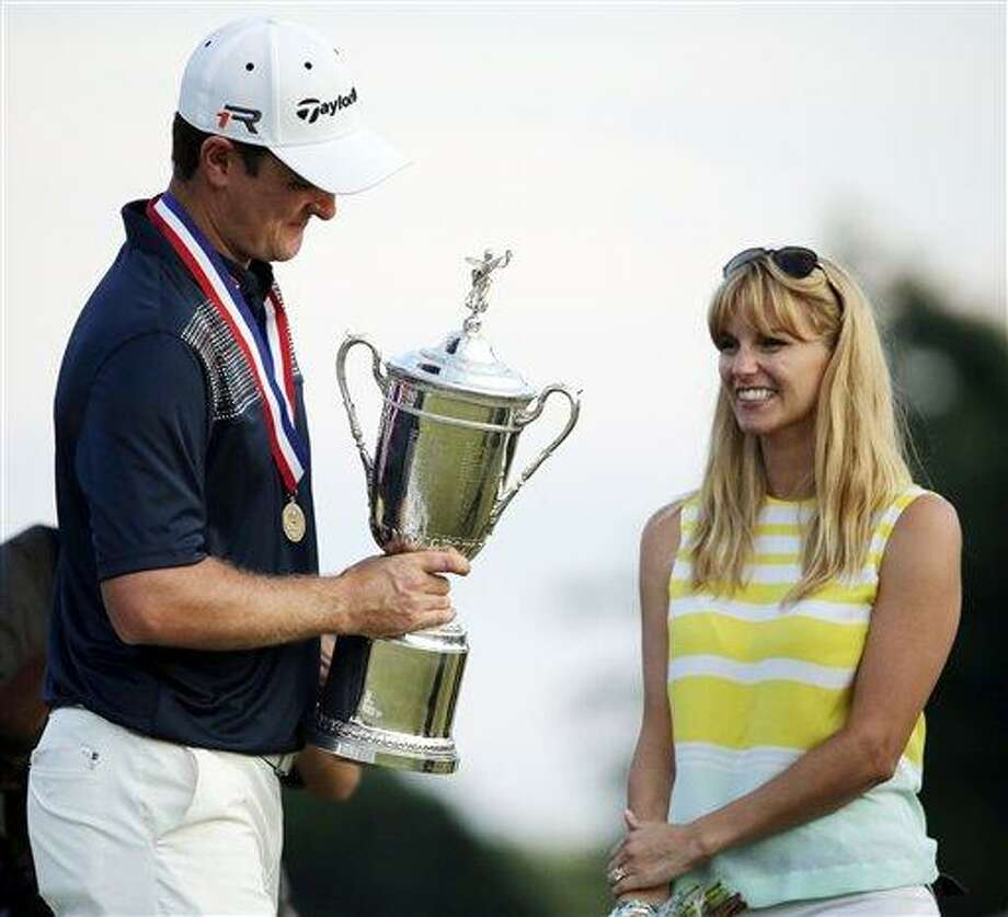 Justin Rose, left, of England, celebrates with his wife Kate after winning the U.S. Open golf tournament at Merion Golf Club, Sunday, June 16, 2013, in Ardmore, Pa. (AP Photo/Charlie Riedel) Photo: AP / AP