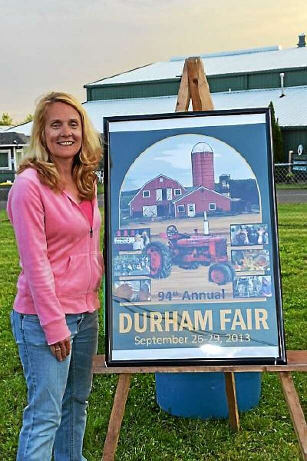 Jen Schulten -- Special to the Press Durham Fair Poster Contest winner Susan Cummings and her artwork.