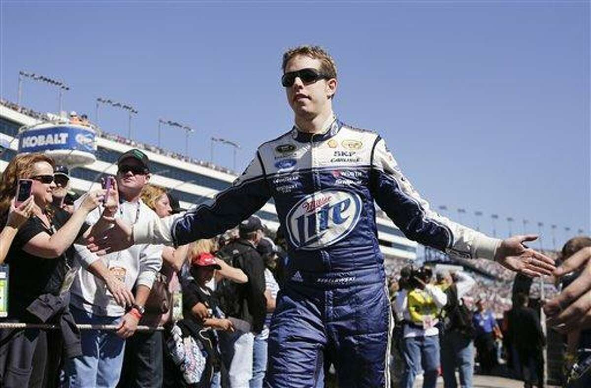 Brad Keselowski greets fans during driver introductions for the NASCAR Sprint Cup Series auto race, Sunday, March 10, 2013 in Las Vegas. (AP Photo/Julie Jacobson)