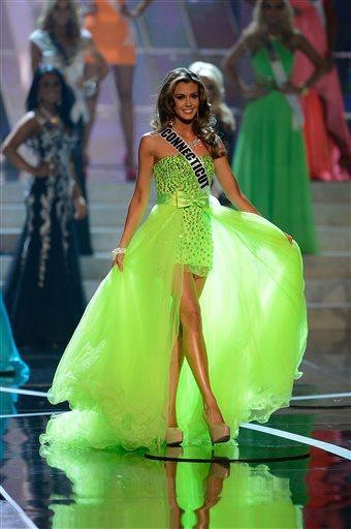 Miss Connecticut Erin Brady, from Glastonbury, Conn., walks the runway during the introductions of the Miss USA 2013 pageant, Sunday, June 16, 2013, in Las Vegas. (AP Photo/Jeff Bottari)