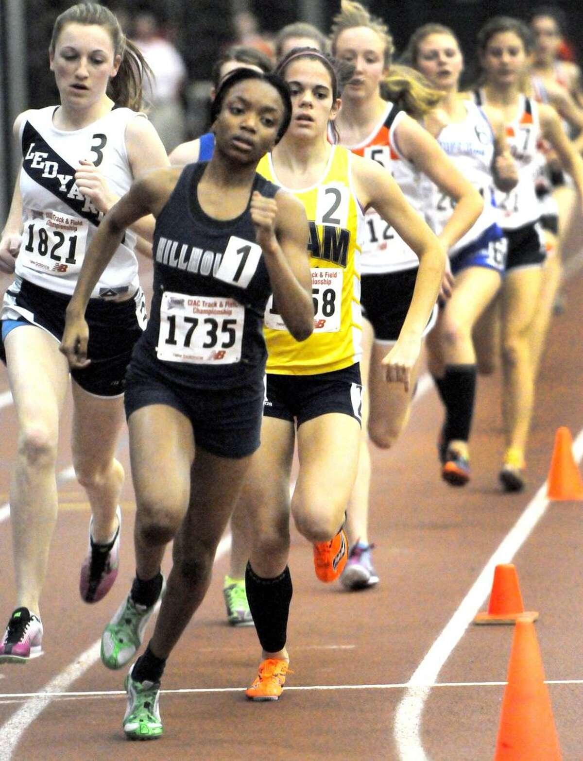 Kellie Davis of Hillhouse H.S. runs to the championship in the 1000 meter during the Class M Indoor Track State Championships Thursday, February 7, 2013 at the Floyd Little Athletic Center in New Haven. Photo by Peter Hvizdak / New Haven Register