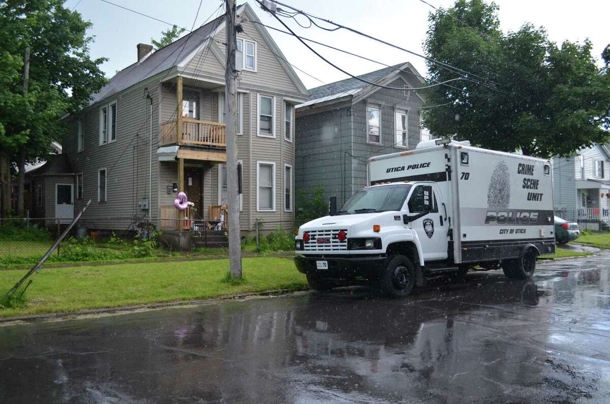 Staff Photo by RACHEL MURPHY -- A Utica Police Crime Scene Unit vehicle sits outside the home of Jevon Wameling and his son Levon, who went missing May 29.