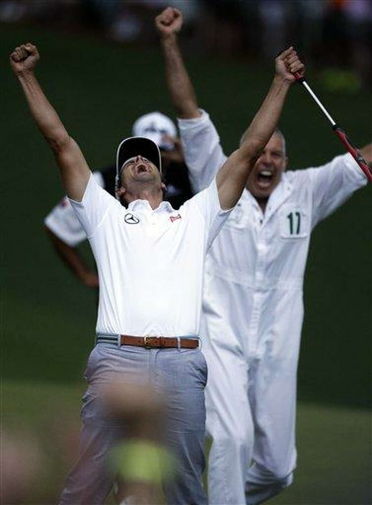 AP Photo/Darron Cummings Adam Scott, of Australia, celebrates with caddie Steve Williams after making a birdie putt on the second playoff hole to win the Masters golf tournament Sunday, April 14, 2013, in Augusta, Ga.