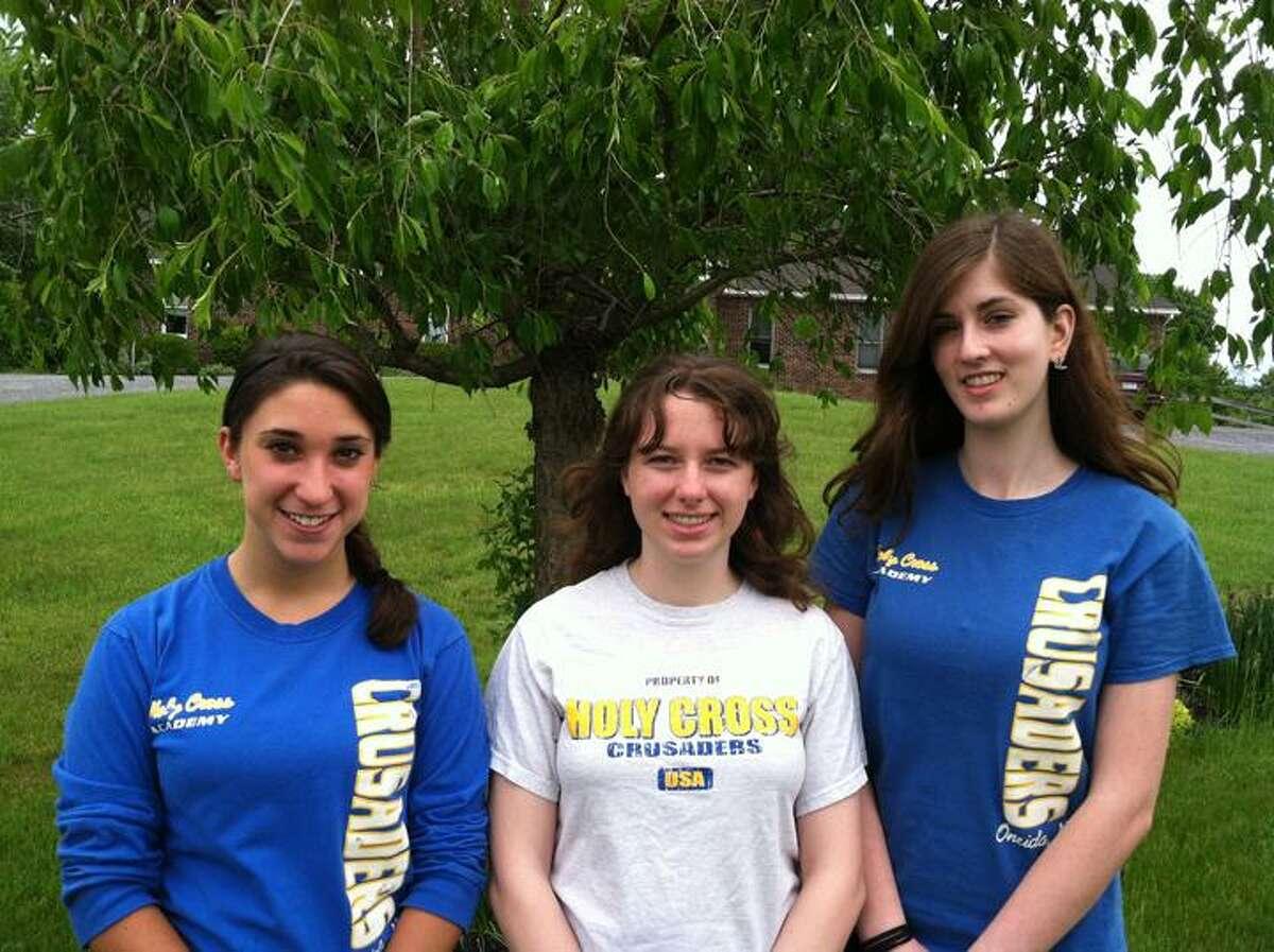 Nick Will/Oneida Daily Dispatch Holy Cross Co-Salutatorian Alanna Glidden, Valedictorian Maggie Vanderhoof, and Co-Salutatorian Kaylee DeZalia.