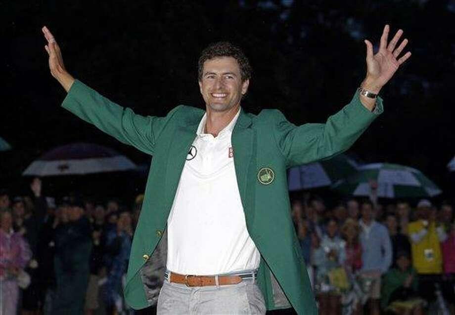 Adam Scott, of Australia, celebrates with his  green jacket after winning the Masters golf tournament Sunday, April 14, 2013, in Augusta, Ga. (AP Photo/Matt Slocum) Photo: ASSOCIATED PRESS / AP2013