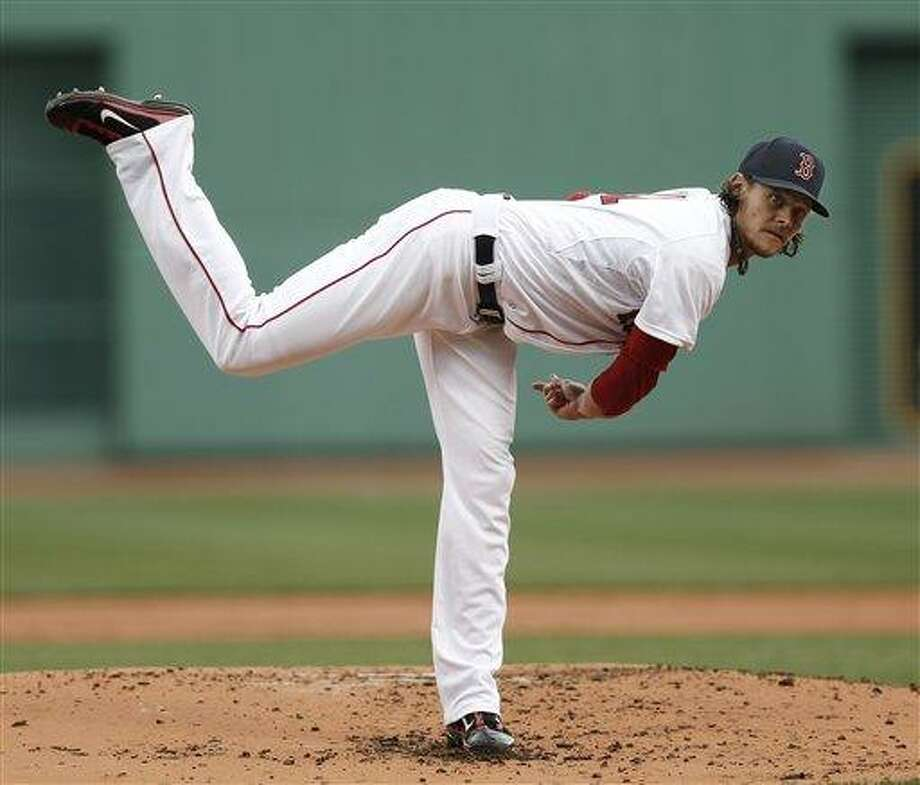 Boston Red Sox starting pitcher Clay Buchholz delivers against the Tampa Bay Rays during the first inning of a baseball game at Fenway Park in Boston Sunday, April 14, 2013. (AP Photo/Winslow Townson) Photo: ASSOCIATED PRESS / AP2013