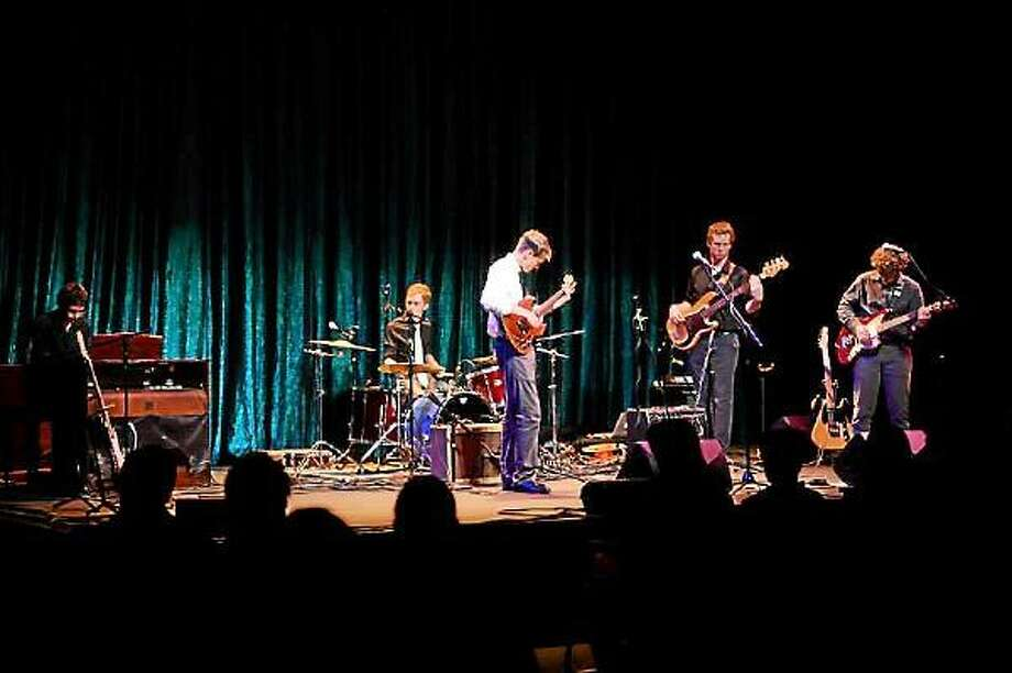 Contributed Photo - From left: Henry Kavle on organ, Elliott Hall on drums, Mike Brightly playing guitar, John Carroll playing bass and Chris Connelly on guitar during their show at the Warner Theatre.