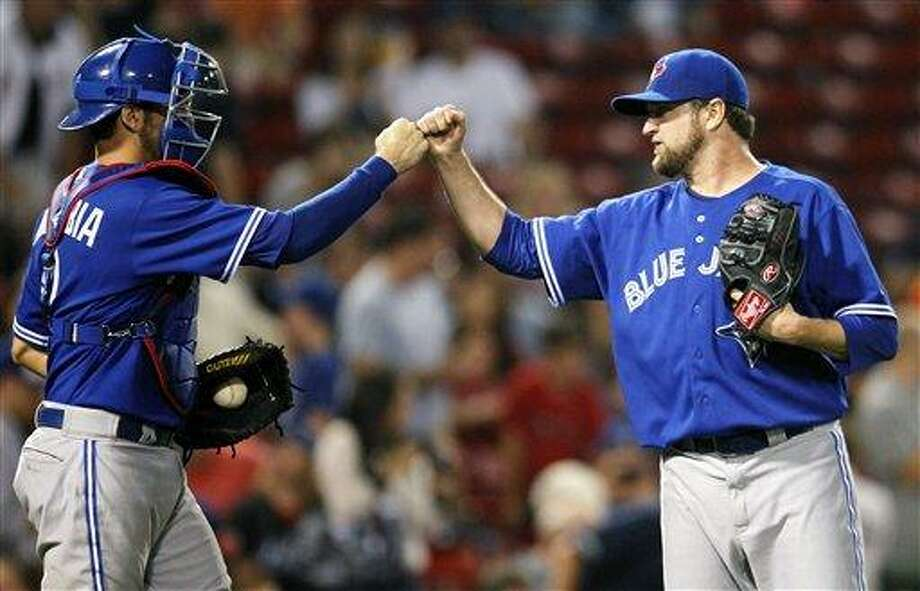 Toronto Blue Jays'  Brandon Lyon, right, celebrates with J.P. Arencibia after defeating the Boston Red Sox 7-5 in a baseball game in Boston, Friday, Sept. 7, 2012. (AP Photo/Michael Dwyer) Photo: ASSOCIATED PRESS / AP2012