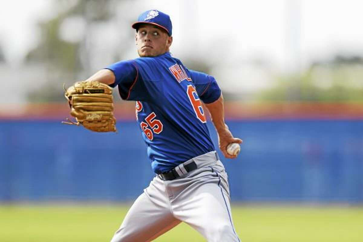 New York Mets pitcher Zack Wheeler throws a live batting practice session during spring training baseball, Wednesday, Feb. 20, 2013, in Port St. Lucie, Fla. (AP Photo/Julio Cortez)