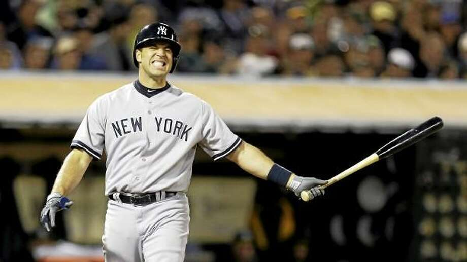 New York Yankees' Mark Teixeira reacts after taking a strike from Oakland Athletics' Jerry Blevins in the eighth inning of a baseball game Tuesday, June 11, 2013, in Oakland, Calif. (AP Photo/Ben Margot) Photo: ASSOCIATED PRESS / AP2013