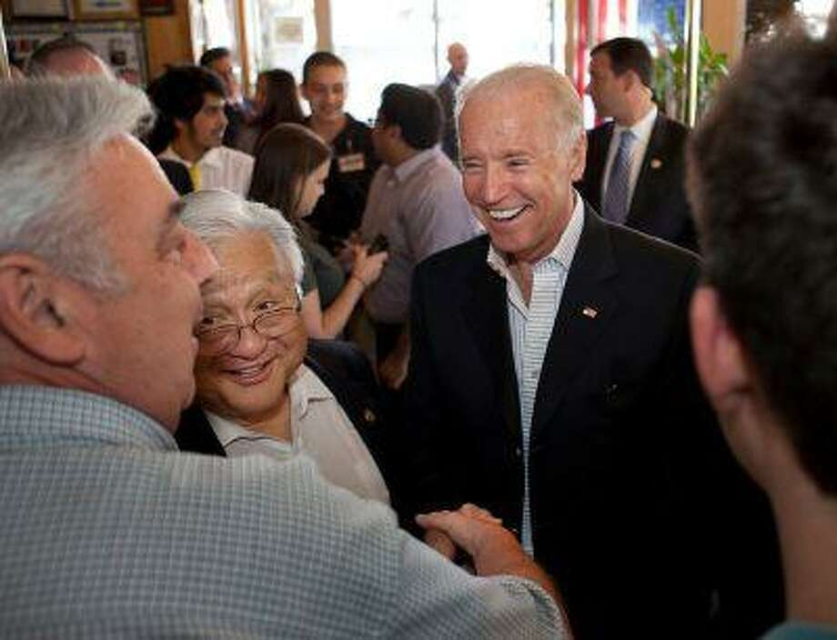 Vice President Joe Biden, right, and Rep. Mike Honda meet and greet diners at Hobee's restaurant in Sunnyvale Saturday, June 15, 2013. Honda is running for reelection. (Patrick Tehan/Staff) Photo: Patrick Tehan / SJMN
