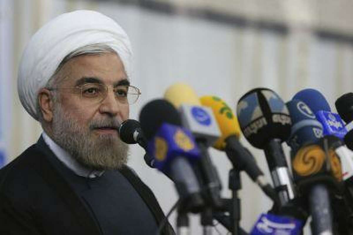 Iranian President-elect Hassan Rohani speaks to the media following a visit to the Khomeini mausoleum in Tehran June 16, 2013.
