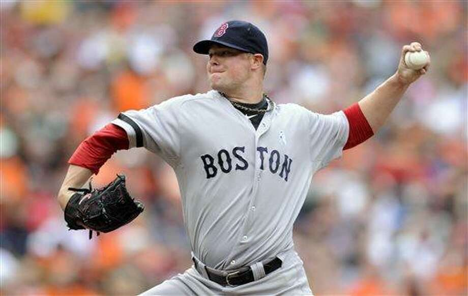 Boston Red Sox starting pitcher Jon Lester delivers against the Baltimore Orioles during the third inning of a baseball game on Sunday, June 16, 2013, in Baltimore. (AP Photo/Nick Wass) Photo: AP / FR67404 AP