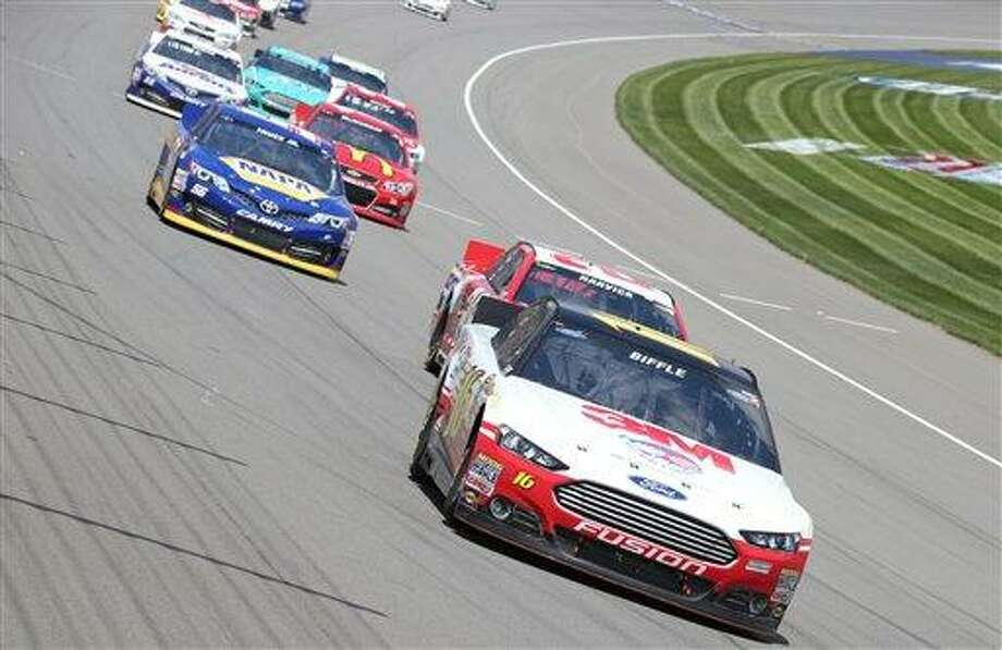 Sprint Cup Series driver Greg Biffle leads through the first turn during the NASCAR Quicken Loans 400 auto race at Michigan International Speedway, Sunday, June 16, 2013 in Brooklyn, Mich. (AP Photo/Bob Brodbeck) Photo: AP / FR3471 AP