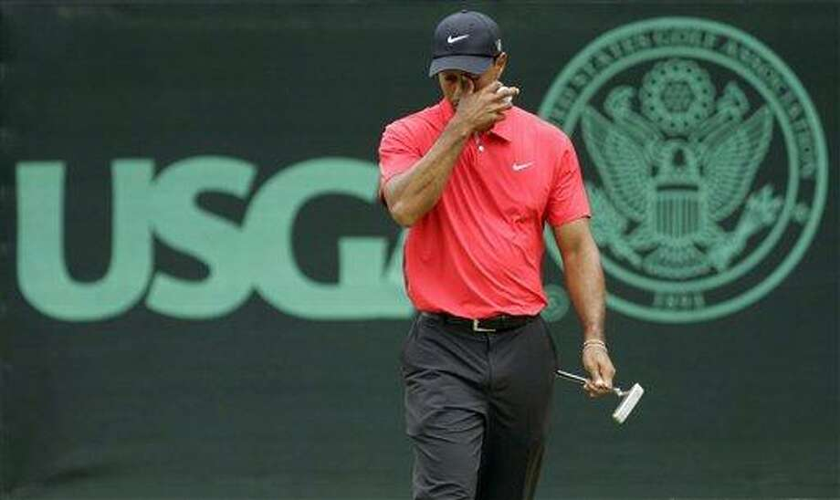 Tiger Woods reacts after putting on the eighth green during the fourth round of the U.S. Open golf tournament at Merion Golf Club, Sunday, June 16, 2013, in Ardmore, Pa. (AP Photo/Gene J. Puskar) Photo: AP / AP