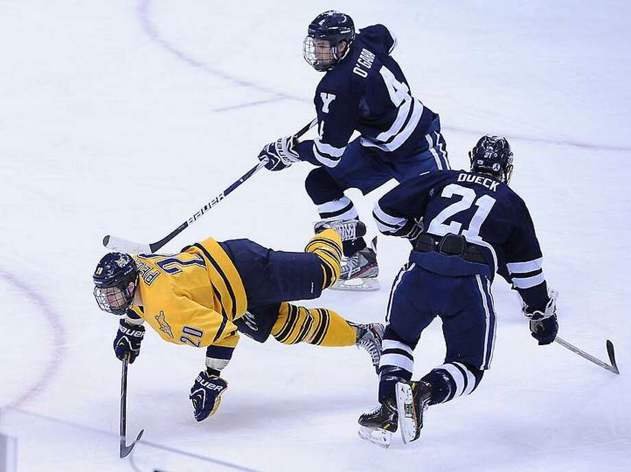 "Pittsburg, PA-- Quinnipiac Vs Yale first period action.  Photo-Peter Casolino/Register <a href=""mailto:pcasolino@newhavenregister.com"">pcasolino@newhavenregister.com</a>"