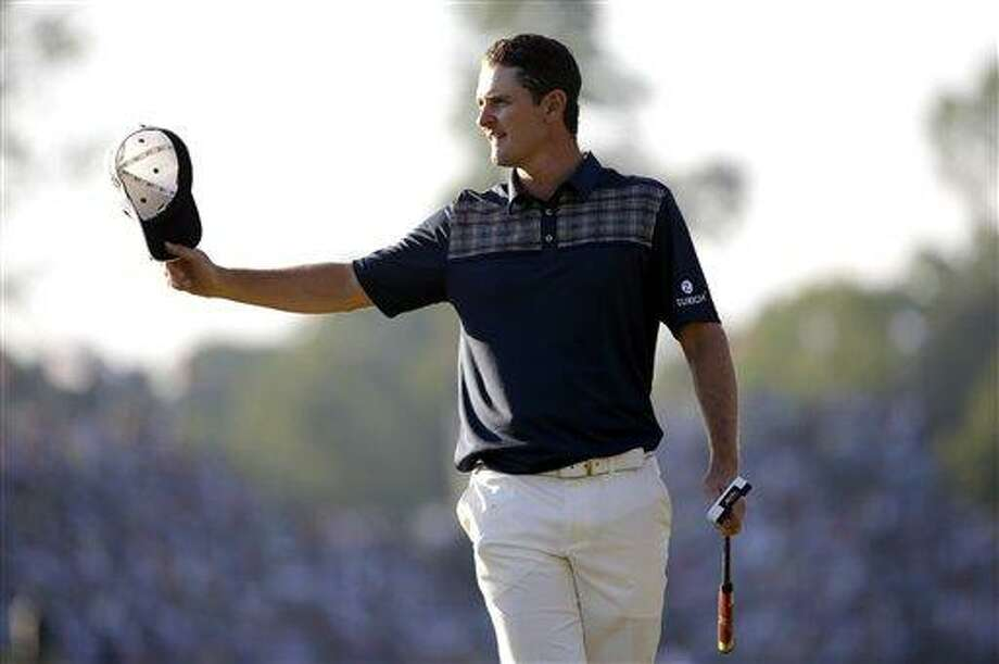 Justin Rose, of England, reacts after a putt on the 18th hole during the fourth round of the U.S. Open golf tournament at Merion Golf Club, Sunday, June 16, 2013, in Ardmore, Pa. (AP Photo/Morry Gash) Photo: AP / AP