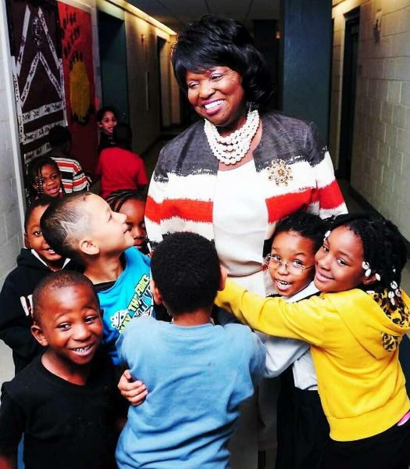 Retiring principal Ramona Gatison is hugged by kindergarteners at Lincoln Bassett School in New Haven on 6/13/2013. Photo by Arnold Gold/New Haven Register
