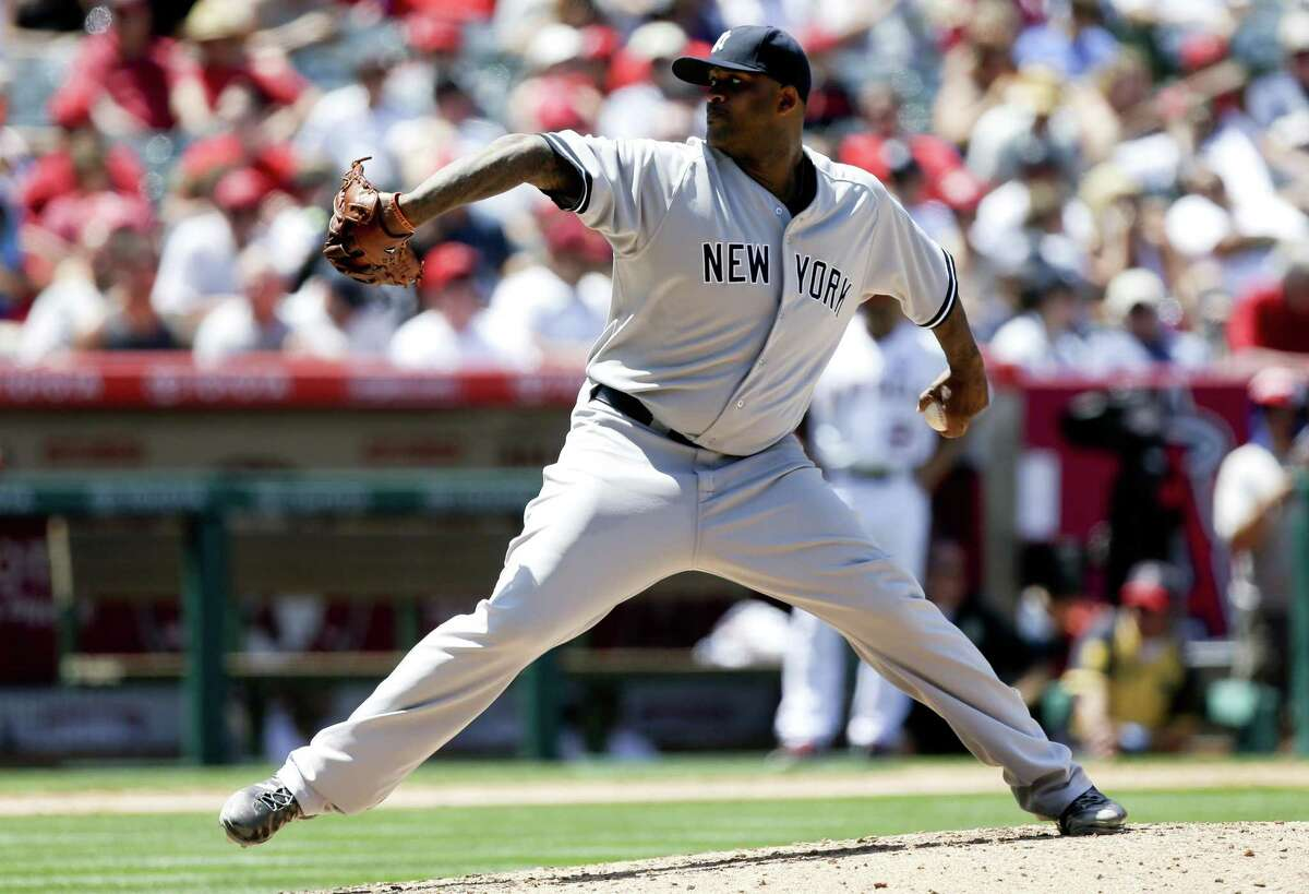 New York Yankees starting pitcher CC Sabathia throws against the Los Angeles Angels during the scond inning of a baseball game in Anaheim, Calif., Sunday, June 16, 2013. (AP Photo/Chris Carlson)