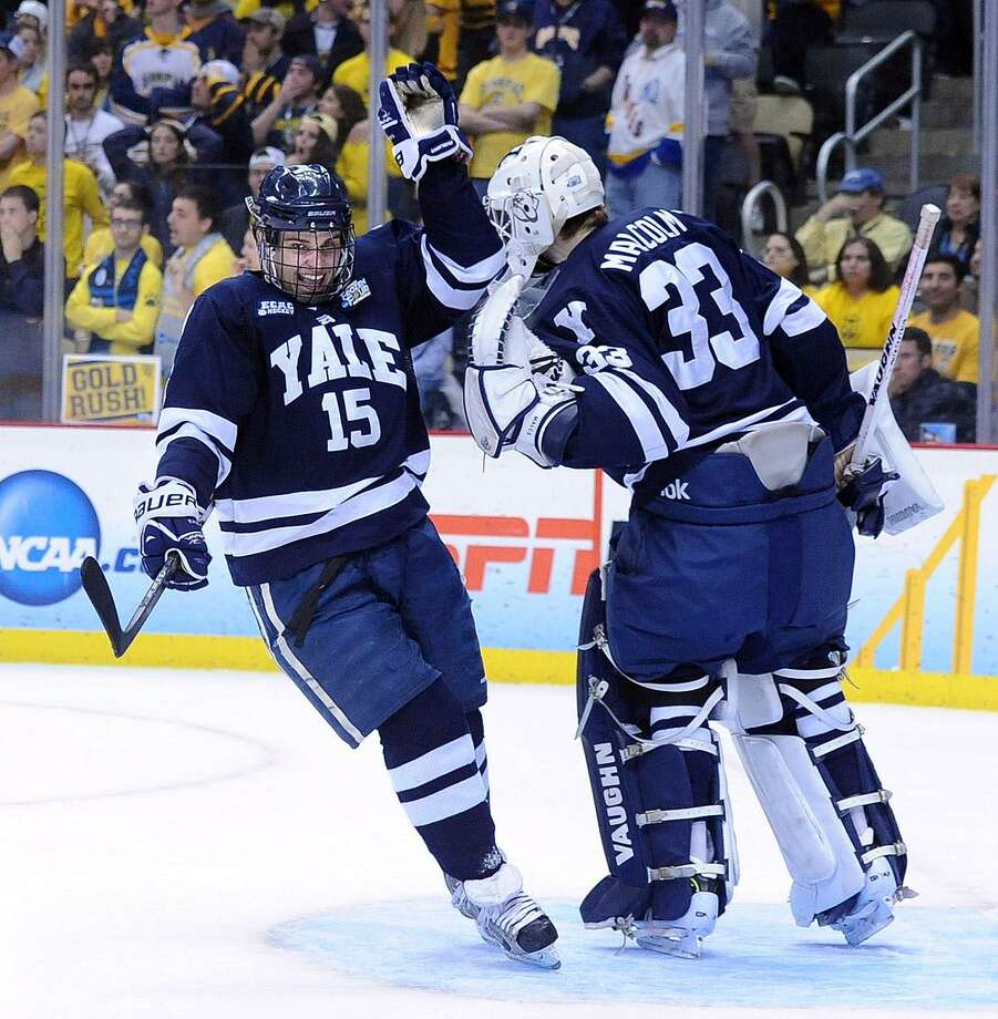 """Pittsburg, PA-- Yale's Clinton Bourbonais celebrates with goalie Jeff Malcolm after scoring against quinnipiac in the final seconds of the second period.  Photo-Peter Casolino/Register <a href=""""mailto:pcasolino@newhavenregister.com"""">pcasolino@newhavenregister.com</a>"""