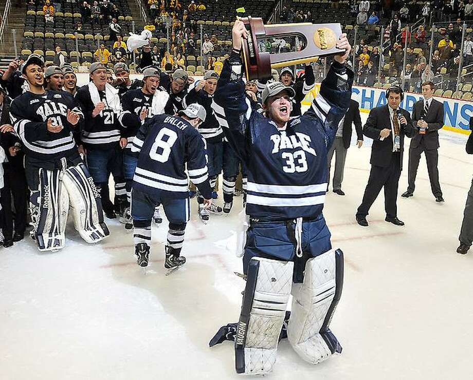 "Pittsburg, PA-- Yale celebrates their win over Quinnipiac for the NCAA Hockey National Championship.  Photo-Peter Casolino/Register <a href=""mailto:pcasolino@newhavenregister.com"">pcasolino@newhavenregister.com</a>"