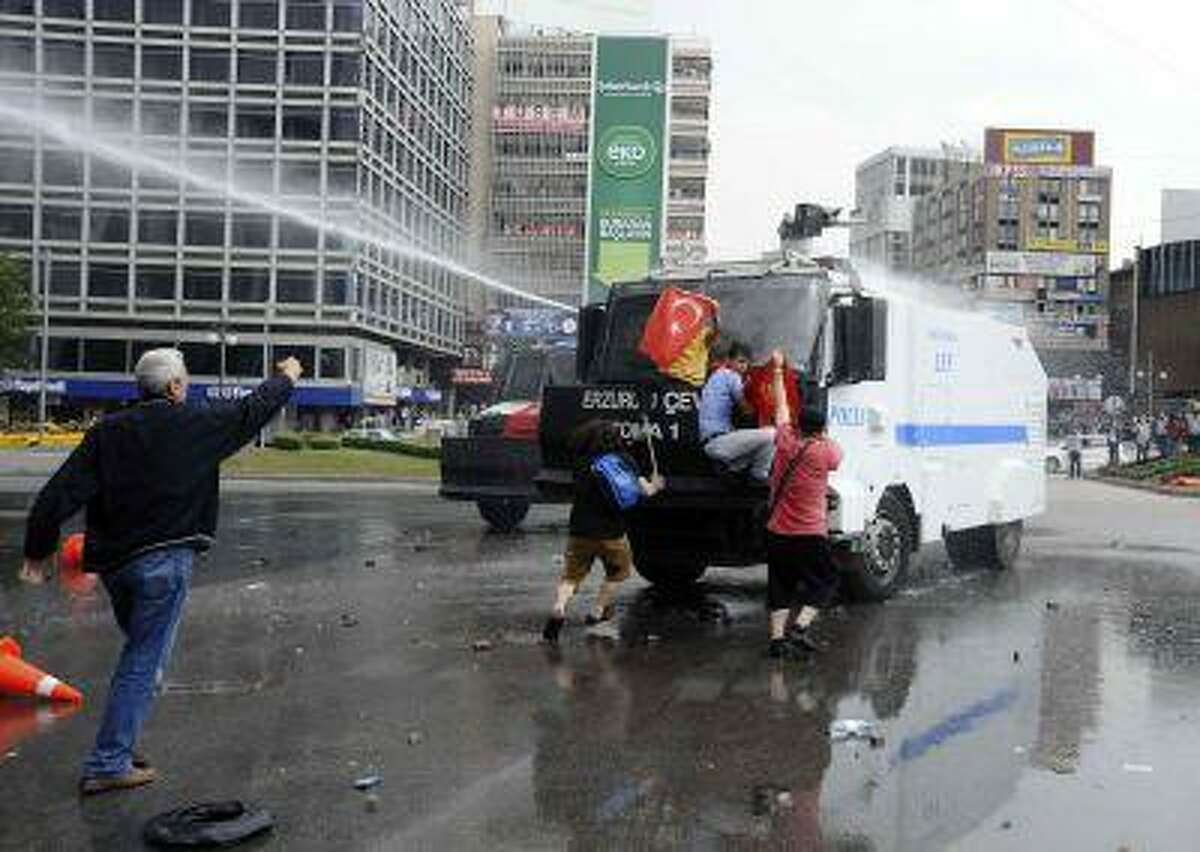 Riot police use a water cannon to disperse anti-government protesters in Ankara June 16, 2013.