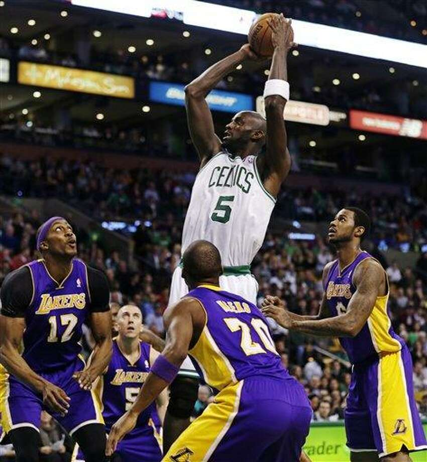 Boston Celtics forward Kevin Garnett (5) shoots while surrounded by Los Angeles Lakers during the first half of an NBA basketball game in Boston, Thursday, Feb. 7, 2013. (AP Photo/Charles Krupa) Photo: ASSOCIATED PRESS / AP2013