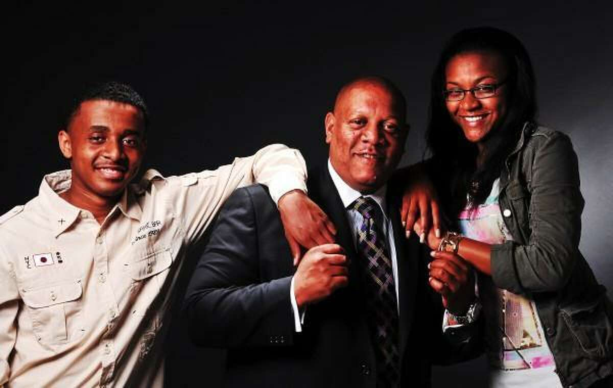 Peter Casolino New Haven Register Father's Day portraits. Scot X. Esdaile with his daughter Imani, age-17, and his son Quran, age-14. pcasolino@newhavenregister.com