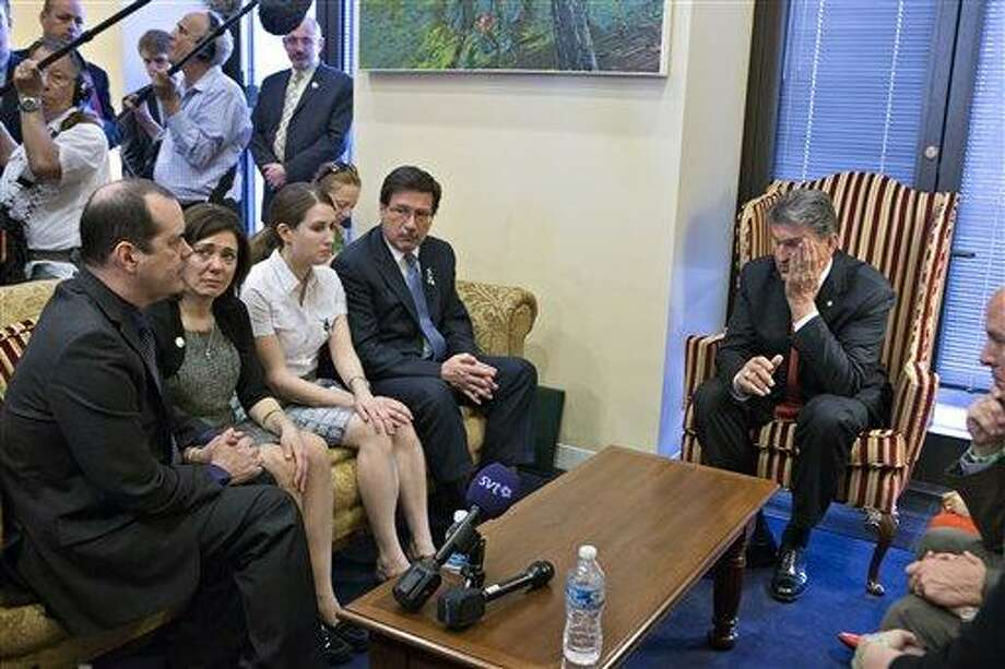 """Sen. Joe Manchin, <a href=""""http://D-W.Va"""">D-W.Va</a>., seated right, meets in his office with families of victims of the  Sandy Hook Elementary School shooting in Newtown, Conn., on the day he announced that they have reached reached a bipartisan deal on expanding background checks to more gun buyers, on Capitol Hill in Washington, Wednesday, April 10, 2013. Seated on sofa from left are David and Francine Wheeler, who lost their six-year-old son Ben in the shooting, Katy Sherlach and her father Bill Sherlach, whose wife Mary Sherlach was killed. At far right is Mark Barden, father of victim Daniel Barden.  (AP Photo/J. Scott Applewhite)  (AP Photo/J. Scott Applewhite) Photo: AP / AP"""