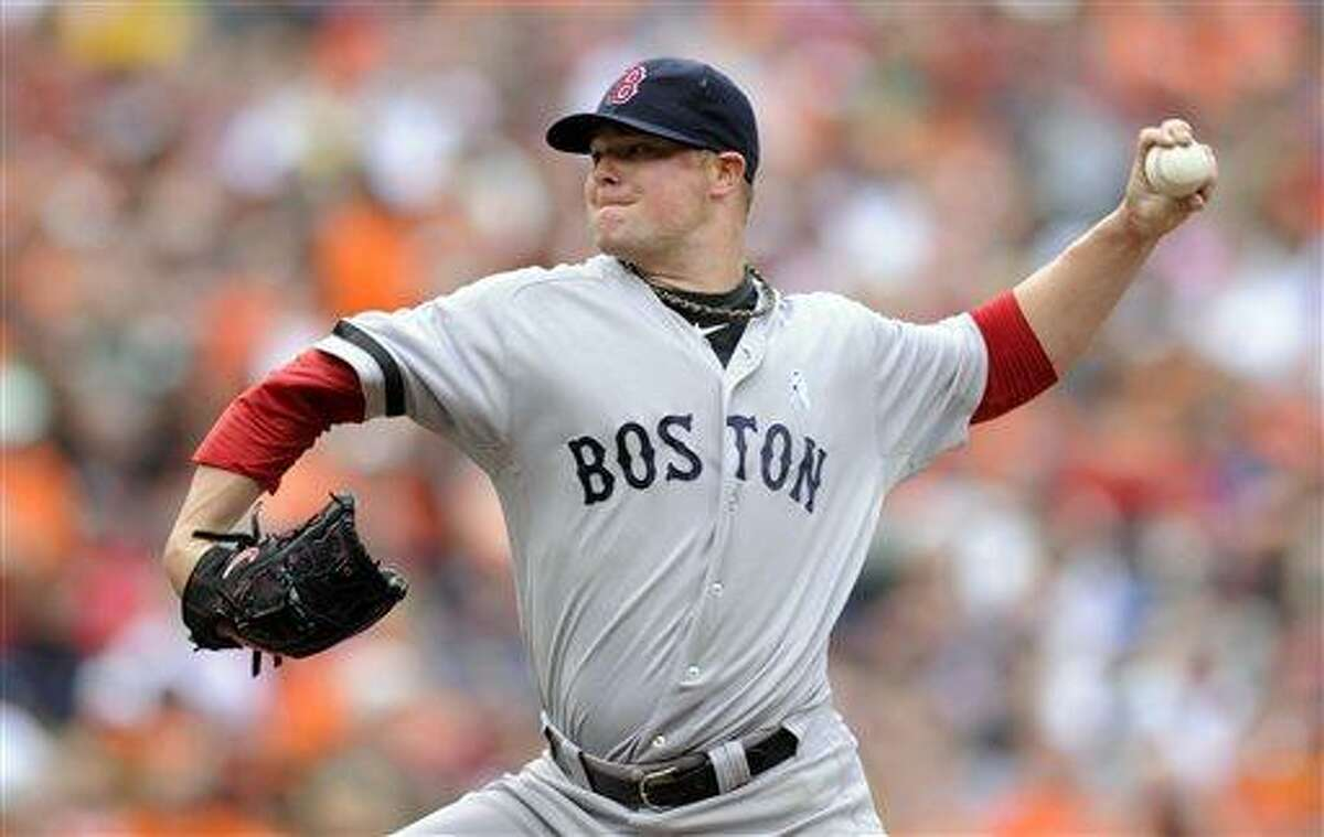 Boston Red Sox starting pitcher Jon Lester delivers against the Baltimore Orioles during the third inning of a baseball game on Sunday, June 16, 2013, in Baltimore. (AP Photo/Nick Wass)